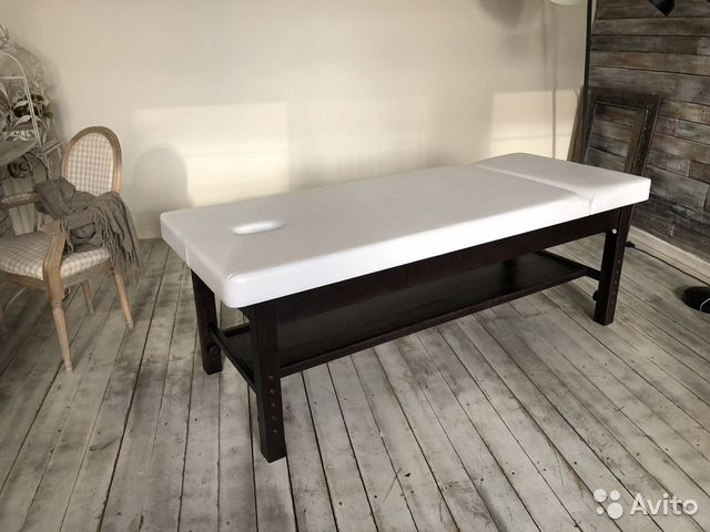 Massage table stationary