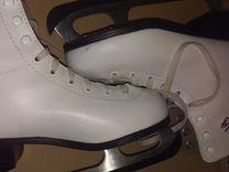 Белые фигурные коньки для девочки